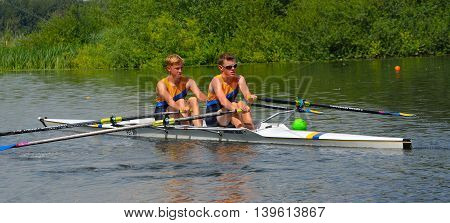 St Neots, Cambridgeshire, England - July 23, 2016: Young men in Pairs Sculling on the river Ouse at St Neots.