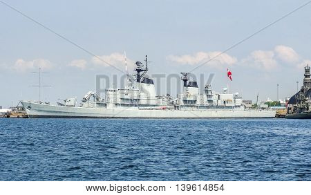 a battleship anchoring in Copenhagen the capital city of Denmark