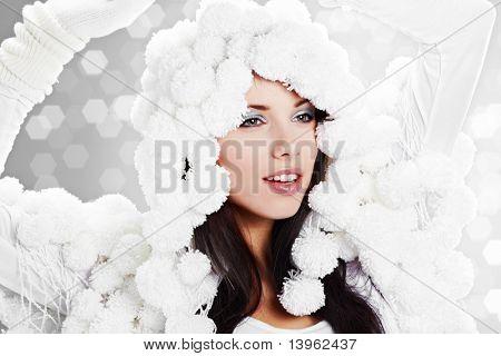 Portrait of a Winter woman. Pom-pon hat