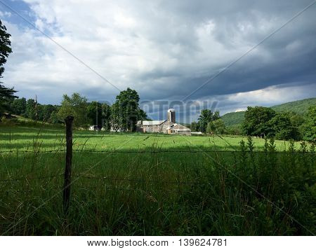 New York Upstate dairy farm with a foreboding sky