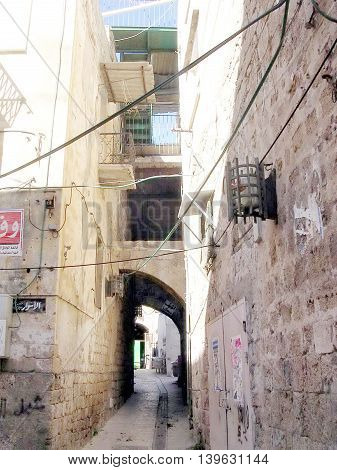 Old small street in the old city of Acre Akko Israel