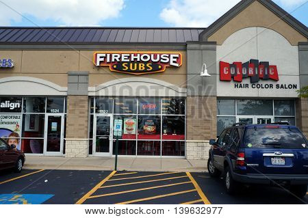JOLIET, ILLINOIS / UNITED STATES - AUGUST 30, 2015: One may eat sandwiches at the Firehouse Subs restaurant, in a Joliet strip mall.