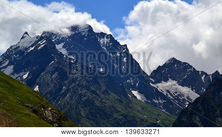Mountain peaks of Dombay in the clouds. The Republic of Karachay-Cherkessia in the North Caucasus Russia. Photo taken on: July 26 Friday 2013