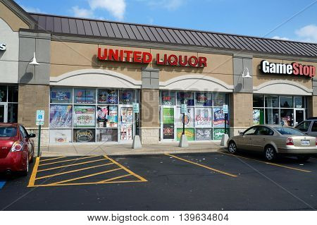 JOLIET, ILLINOIS / UNITED STATES - AUGUST 30, 2015: One may purchase liquor at the United Liquor store in a Joliet strip mall.