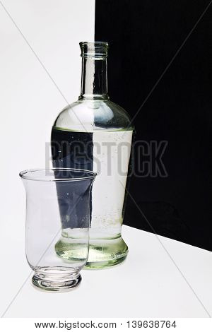 bottle with black and white pattern filled with water