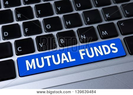 MUTUAL FUNDS a message on keyboard man hand