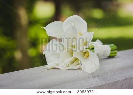 beautiful wedding bouquet of white flowers calla