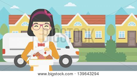 An asian  female baker holding a box of cakes. A baker delivering cakes. Baker with cupcakes standing on the background of delivery truck. Vector flat design illustration. Horizontal layout.