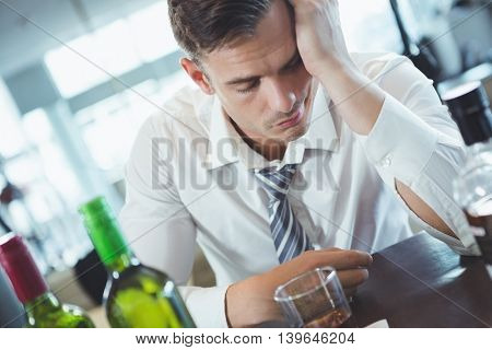 Drunken man sleeping on a bar counter at restaurant