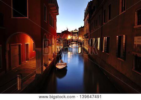 Venetian canal at night Venice Italy Europe