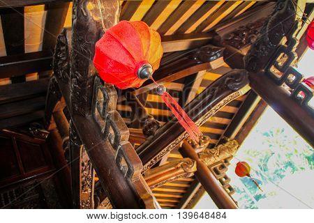 Lanterns underneath Chinese Architechture home in Vietnam