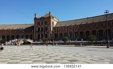 Seville, Spain - June 22, 2016: Plaza de Espana in Seville, Spain. Tourists are visiting the Plaza de Espana.