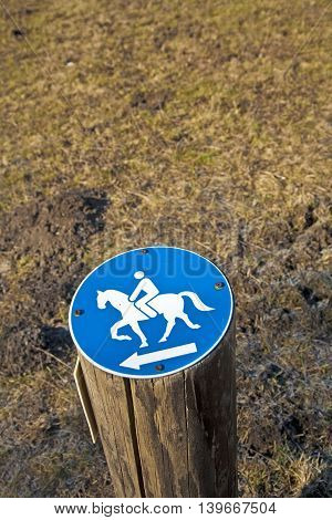 sign riding allowed nailed on a stem in the forest
