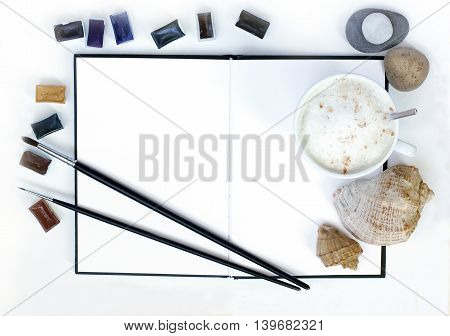 inspiration object frothy coffee notebook paint sea stones and seashells flat lay top view