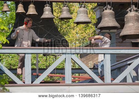 Kiev Ukraine - May 05 2016: Bell-ringers play on the set of bells of Holy Trinity Monastery of St. Jonas