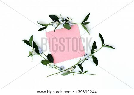 background with spring flowers as a frame and blank sheet for congratulations top view/ spring congratulatory card