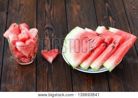 Slices Of Watermelon On Plate And Glass With Heartshape