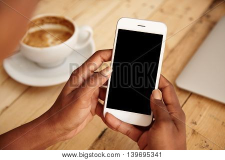 Cropped Shot Of Black Female's Hands Holding Mobile Phone With Blank Copy Space Screen For Your Text