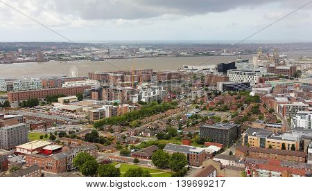 LIVERPOOL, ENGLAND, JULY 2. Pier Head and the Mersey River on July 2, 2016, in Liverpool, England. Liverpool landmarks include the Exhibition Centre Echo Arena the Big Wheel Albert Dock Museum of Liverpool The Royal Liver Building Merseyside Cunard Buildi