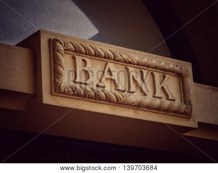 Bank sign in stone over a doorway