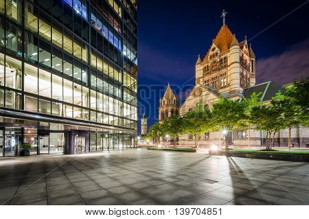 The John Hancock Tower And Trinity Church At Night, At Copley, In Back Bay, Boston, Massachusetts.