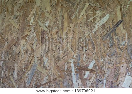 The texture of compacted sawdust wood pieces of different structures boards hardboard panel