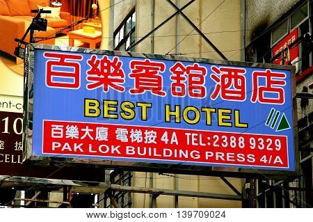 Hong Kong China - January 7 2006: Sign in both English and Chinese for the Best Hotel on Nathan Road hangs over the street on metal poles