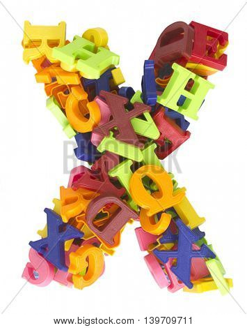 the letter X made from a lot of Magnetic letters