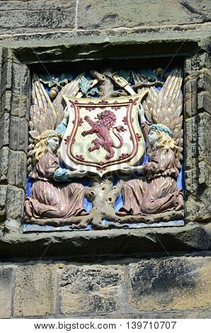 A view of the coat of arms on the entrance turret at Falkland Palace