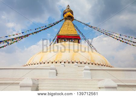 Photo of Boudhanath Stupa in the Kathmandu valley with clouds the sky Nepal. Horizontal