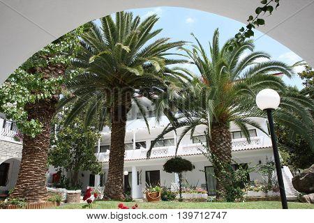 NIKITI, GREECE-JUl 07 2016: View at inboard garden in Porfi Beach hotel, Greeece