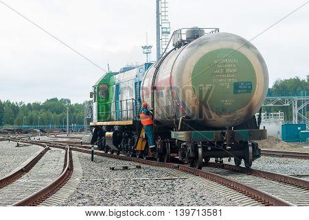 Tobolsk, Russia - July 15. 2016: Sibur company. Denisovka railway station. Shunting locomotive transports the tank on other way