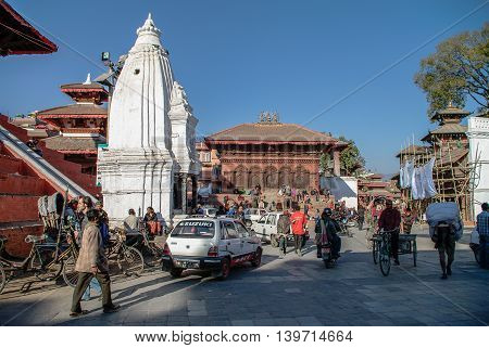 Kathmandu, Nepal -December 28, 2011: People bikes and cars on Hanuman Dhoka square