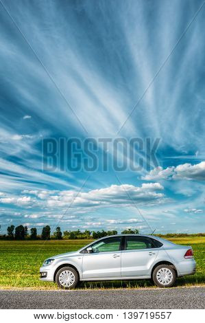 Gomel Belarus - June 13 2016: Volkswagen Polo Car Parking On A Roadside Of Country Road On A Background Of Green Spring Fields