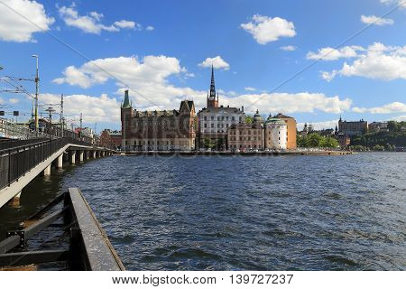 STOCKHOLM, SWEDEN - JUNE 27, 2016: Island Riddarholmen is a separate part of the old Gamla Stan away from the main shopping streets. There is a beautiful church with forged metal spire.