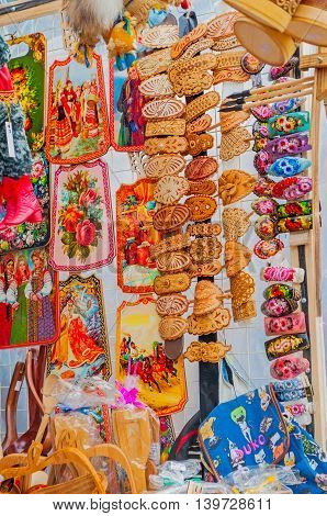 VELIKY NOVGOROD RUSSIA-JULY 22 2016. Souvenir trade - wooden jewelry and various souvenir objects with patterns in Slavic style at the street souvenir trade in Veliky Novgorod Russia