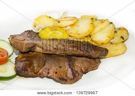 T Bone steak with potatoes and vegetables