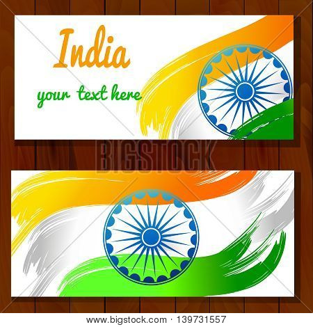Vector illustration for the India Independence Day. 2 Greeting cards for celebration of India Independence Dayin made of yellow green white Indian Flag colors with Ashoka Wheels on a wood background