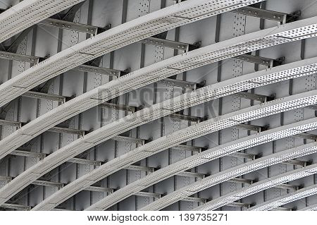 Shot of the underside of a bridge showing the support girders