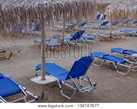 The sunbeds and umbrellas on the beach