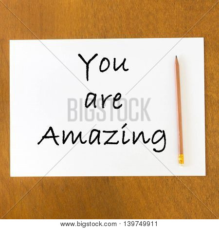 Inspirational Motivational Quote On Blank Paper And Pencil On The Wooden Table Background.
