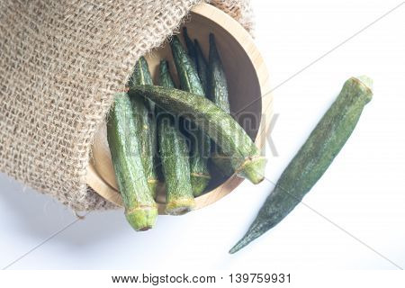 Healthy okra chips on clean background stock photo