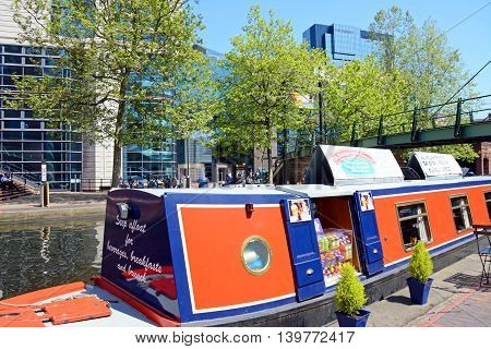 BIRMINGHAM, UNITED KINGDOM - JUNE 6, 2016 - Snack shop aboard a narrowboat with views towards the rear of the ICC Birmingham England UK Western Europe, June 6, 2016.