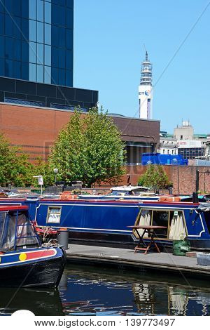 BIRMINGHAM, UNITED KINGDOM - JUNE 6, 2016 - Narrowboats at Gas Street Basin with the BT tower to the rear Birmingham England UK Western Europe, June 6, 2016.