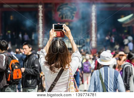 Tokyo Japan - April 9 2016: Tourist visit and taking photo of Sensoji also known as Asakusa Kannon Temple is a buddhist temple located in Asakusa. It is one of Tokyo's most colorful and popular.