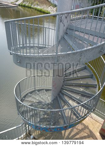 Round Steel Outdoor Staircase To A River
