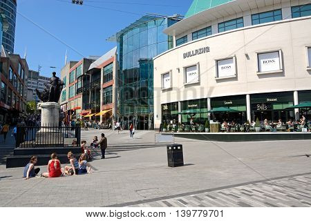 BIRMINGHAM, UNITED KINGDOM - JUNE 6, 2016 - People enjoying the Summer sunshine at the Bull Ring shopping area Birmingham England UK Western Europe, June 6, 2016.