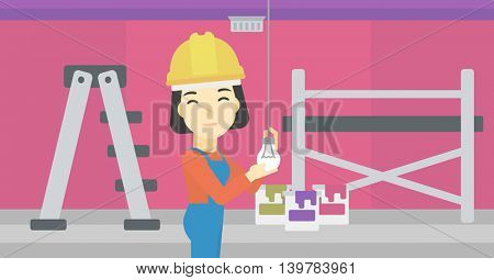 An asian female electrician twisting a light bulb. An electrician installing light in an apartment. Electrician changing light bulb. Vector flat design illustration. Horizontal layout.