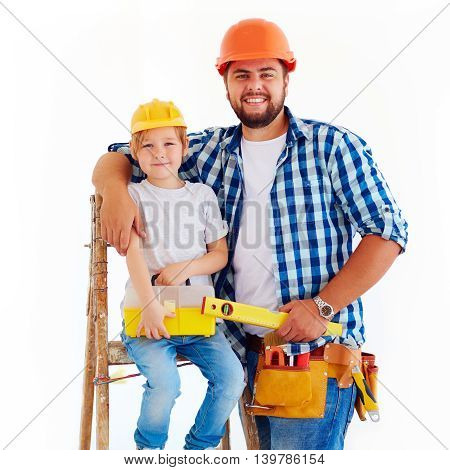 Happy Father And Son Ready To Repair A House