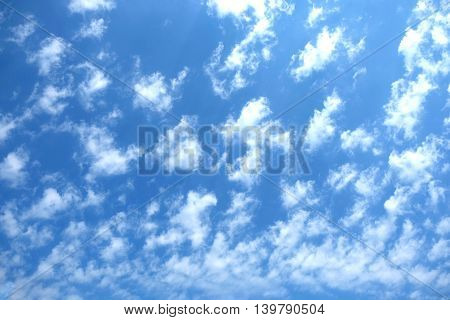 Beautiful celestial landscape with white clouds high in the stratosphere on a sunny summer day horizontal view